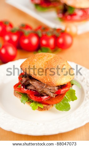 Pulled Pork Slider Sandwich with Peppers and Tomatoes - stock photo