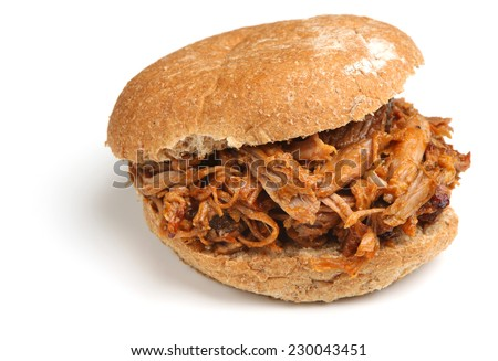 Pulled pork with barbeque sauce in a soft bread roll. - stock photo