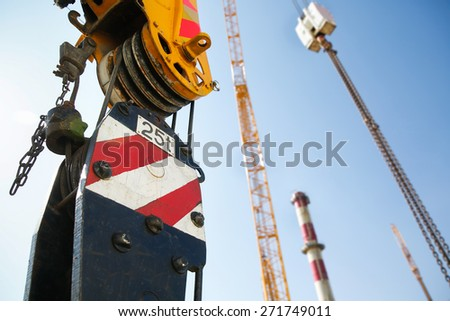 Pulley of a mobile lifting crane on a construction site, capable of lifting 25 tons of load. Heavy duty machinery for heavy construction industry.  - stock photo