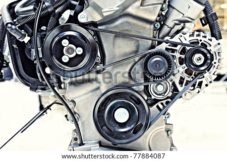 pulleys with belt in the car motor - stock photo