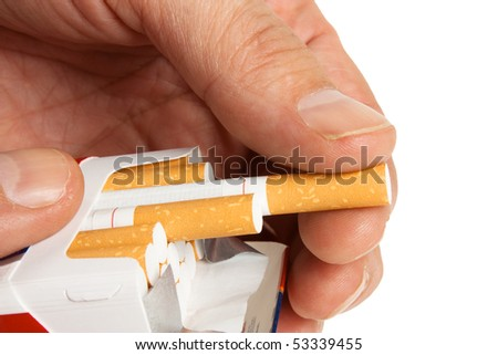 pulling a cigarette from the pack isolated on white background