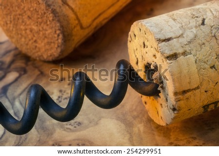 Pulling cork from a wine bottle using a corkscrew - stock photo