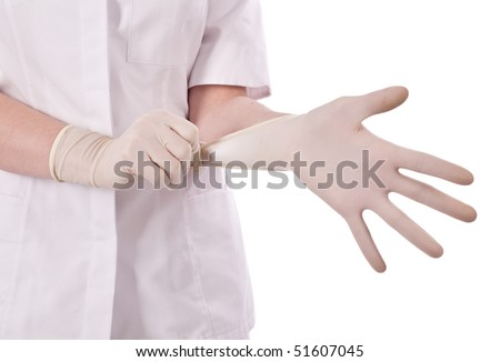Pulling on surgical glove - stock photo