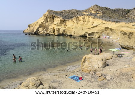 Pulpi, Spain - July 31 People enjoying on the beautiful beach of the cookers in summer. Pulpi, Almeria July 31, 2012 - stock photo