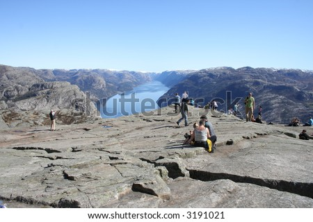 Pulpit Rock at Lysefjorden in Norway. A well known tourist attraction towering 600 meters over sea level. - stock photo