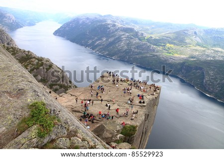 Pulpit Rock at Lysefjorden in Norway. A well known tourist attraction towering 604 meters over sea level - stock photo