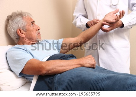 Pulse being taking on a middle aged man's wrist.