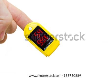 pulse oximeter on a mans finger - stock photo
