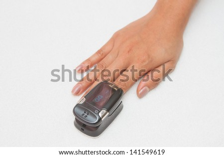 Pulse Oximeter,Patient with pulse oximeter on finger - stock photo