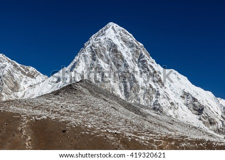 Pumori mountain and Kala Patthar - mount Everest view point. Trail leading up to Kala Patthar hill. Everest Base Camp Trek, Himalayas, Nepal. Beaytiful mountain summit landscape. - stock photo