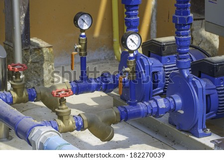 Pump and a pressure gauge. - stock photo