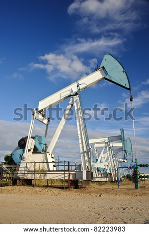 Pump jack. Extraction of oil in Western Siberia, Russia. - stock photo
