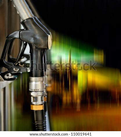 Pump nozzles at the gas station - stock photo