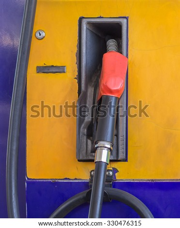 Pump nozzles at the gas station. - stock photo