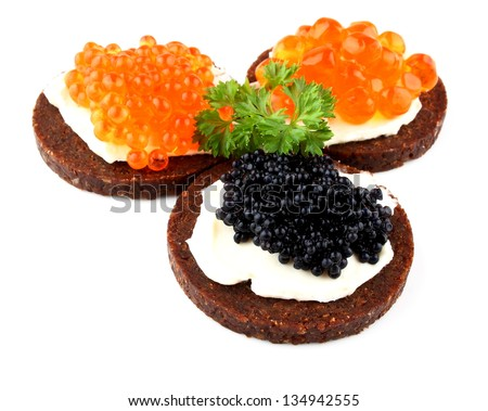 Pumpernickel bread with red and black caviar, top view - stock photo