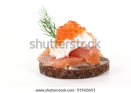 Pumpernickel bread with smoked salmon, cream cheese, caviar and dill - stock photo