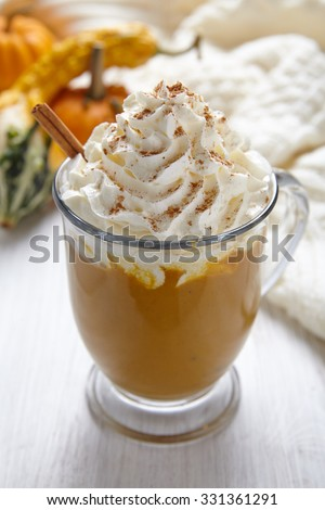 Pumpin latte with whipped cream and spices - stock photo