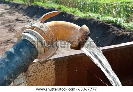 pumping away groundwater in a basin - stock photo