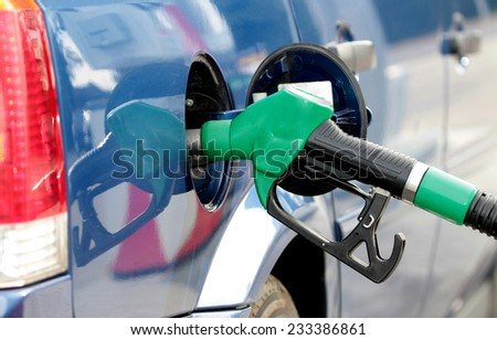 Pumping fuel in to the tank - stock photo