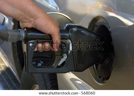 Pumping Gas. - stock photo