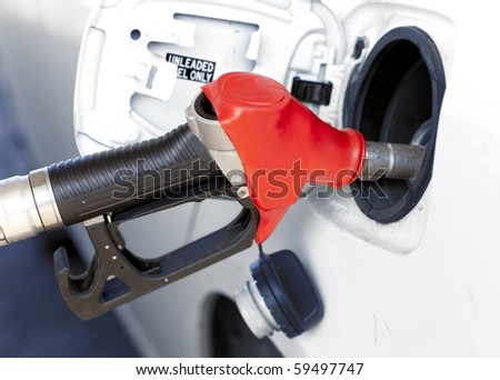 pumping gas in to the tank - stock photo