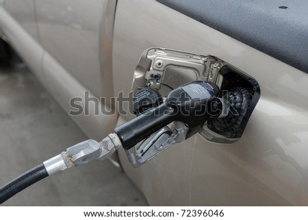 pumping gasoline at the gas station - stock photo