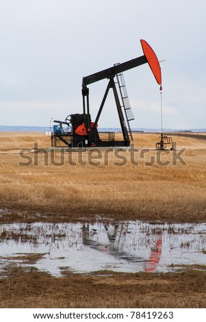 Pumpjack in northern Alberta, Canada. A piece of equipment used in the oil and gas industry. - stock photo