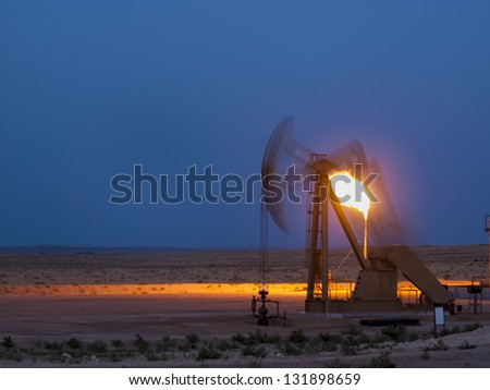 Pumpjack with flame at Pawnee National Grassland in Weld County, of northeastern Colorado. - stock photo