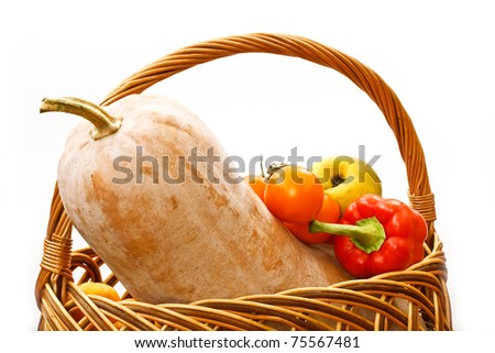 pumpkin and harvest in a basket on a white background