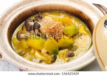 Pumpkin and mushroom stew in claypot - stock photo