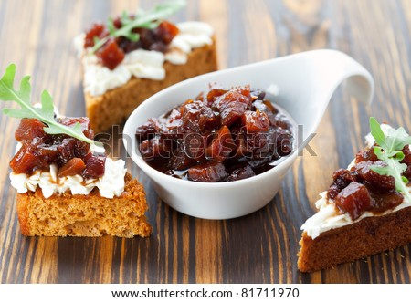 Pumpkin and tomato chutney on pumpkin bread with soft cheese - stock photo