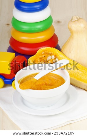 Pumpkin baby soup puree in wooden backgroung - stock photo