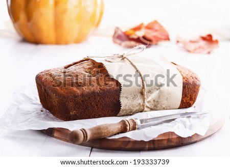 Pumpkin bread loaf over white wooden background. Selective focus, shallow Depth of Field - stock photo