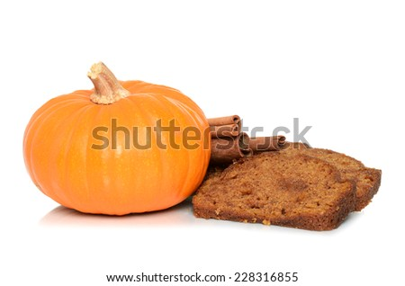 pumpkin bread slices with whole pumpkin and cinnamon sticks - stock photo