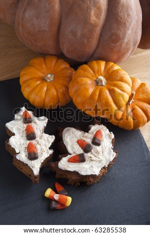 Pumpkin bread with frosting and candy topping - stock photo
