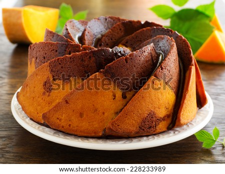 Pumpkin chocolate cake with frosting. - stock photo