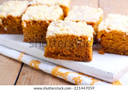 Pumpkin coffee cake with topping, cut on squares - stock photo