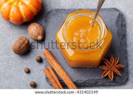 Pumpkin confiture, jam, sauce with spices on stone table Top view - stock photo