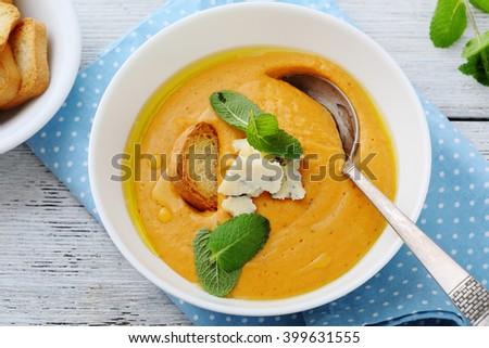 pumpkin cream soup in bowl, top view - stock photo