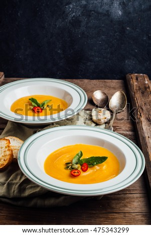 Pumpkin cream soup on a wooden table