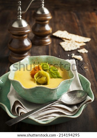 Pumpkin cream soup with cheese tortellini - stock photo