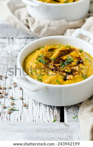 Pumpkin cream soup with lentils - stock photo
