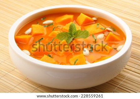 Pumpkin curry sauce in white bowl. - stock photo