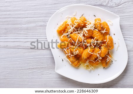 pumpkin gnocchi with cheese and spices on the plate closeup. horizontal top view  - stock photo