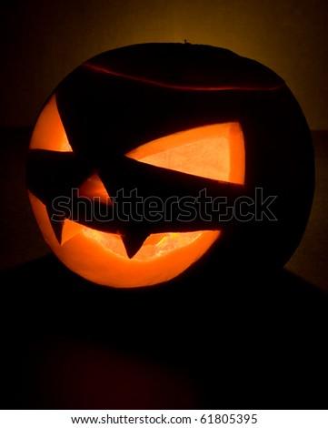Pumpkin head. Halloween decoration, on black background. - stock photo