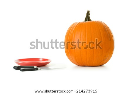 Pumpkin: Jack O Lantern In The Process Of Being Carved For Halloween - stock photo