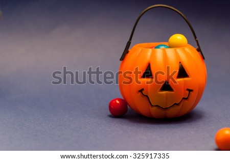 Pumpkin jack with colorful bubble gum - stock photo