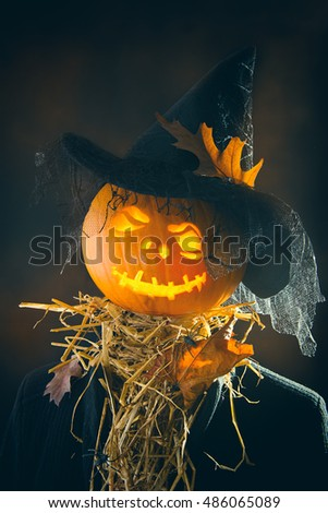 Pumpkin man wearing a witches hat