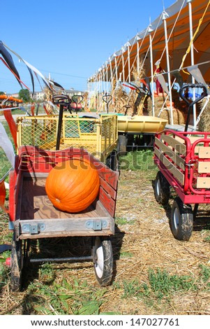 Pumpkin on a red wagon - stock photo