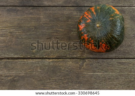 Pumpkin on a rustic wooden background. Fall series.